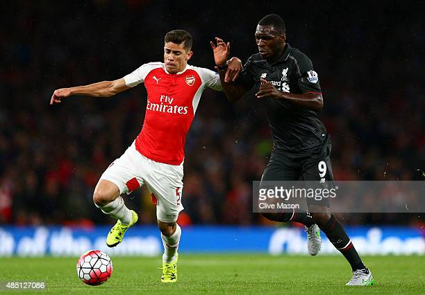 Gabriel Paulista of Arsenal battles for the ball with Christian Benteke of Liverpool during the Barclays Premier League match between Arsenal and...
