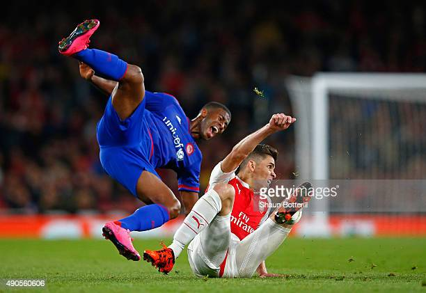 Gabriel Paulista of Arsenal challenges Seba of Olympiacos during the UEFA Champions League Group F match between Arsenal FC and Olympiacos FC at the...