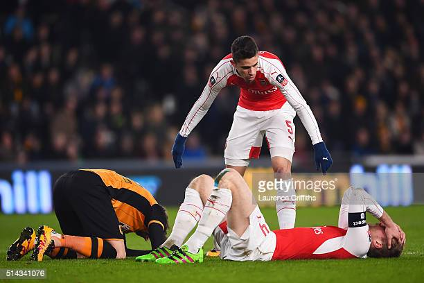 Gabriel Paulista of Arsenal checks on Per Mertesacker of Arsenal after a clash of heads during the Emirates FA Cup Fifth Round Replay match between...