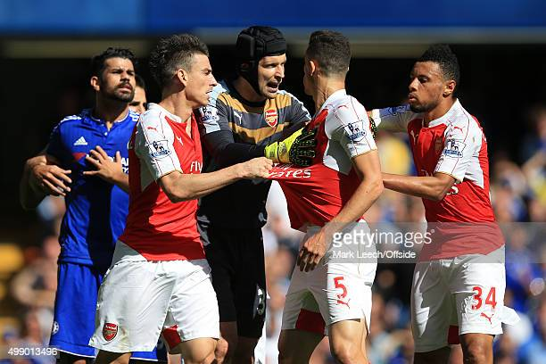 Gabriel Paulista of Arsenal clashes with Diego Costa of Chelsea as team mates try to intervene during the Barclays Premier League match between...
