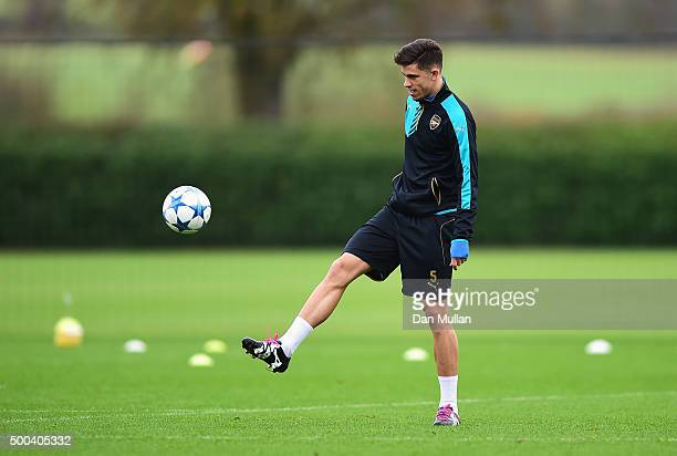 Gabriel Paulista of Arsenal controls the ball during an Arsenal training session ahead of the UEFA Champions League match against Olympiacos at...