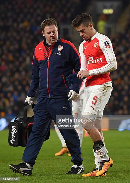Gabriel Paulista of Arsenal leaves the field injured during the Emirates FA Cup Fifth Round Replay match between Hull City and Arsenal at KC Stadium...