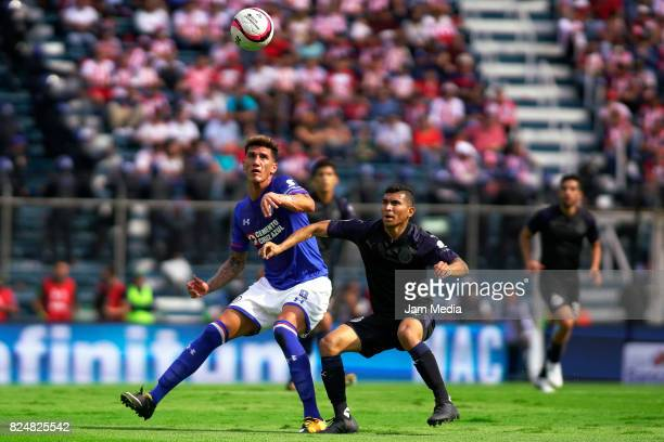 Gabriel Penalba of Cruz Azul and Orbelin Pineda of Chivas fight for the ball during the 2nd round match between Cruz Azul and Chivas as part of the...