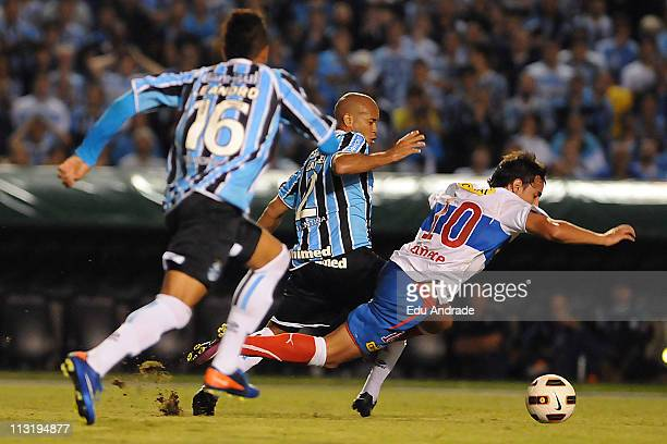 Gabriel player of Gremio struggles for the ball with Canete of Universidad Catolica in the final round of Santander Libertadores Cup 2011 in the...