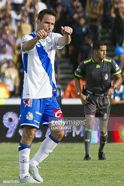 Gabriel Rey of Puebla celebrates after scoring against Pumas during their Mexican Apertura football tournament in Puebla Puebla State Mexico on...