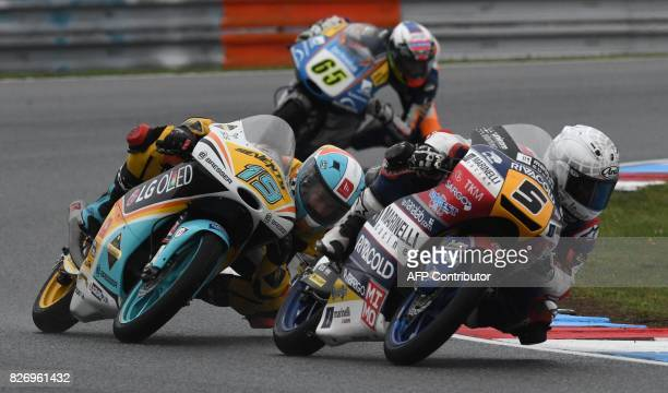 Gabriel Rodrigo of Argentina and Romano Fenati of Italy compete during the Moto3 event of the Grand Prix of the Czech Republic in Brno on August 6...