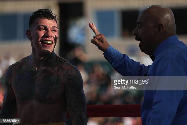 Gabriel Rosado smiles at referee Ray Corona during a middleweight bout against Antonio Gutierrez at StubHub Center on June 4 2016 in Carson California