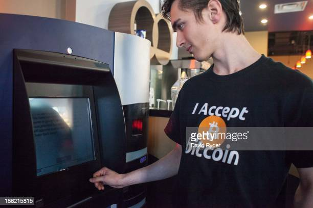 Gabriel Scheare uses the world's first bitcoin ATM on October 29 2013 at Waves Coffee House in Vancouver British Columbia Scheare said he 'just felt...