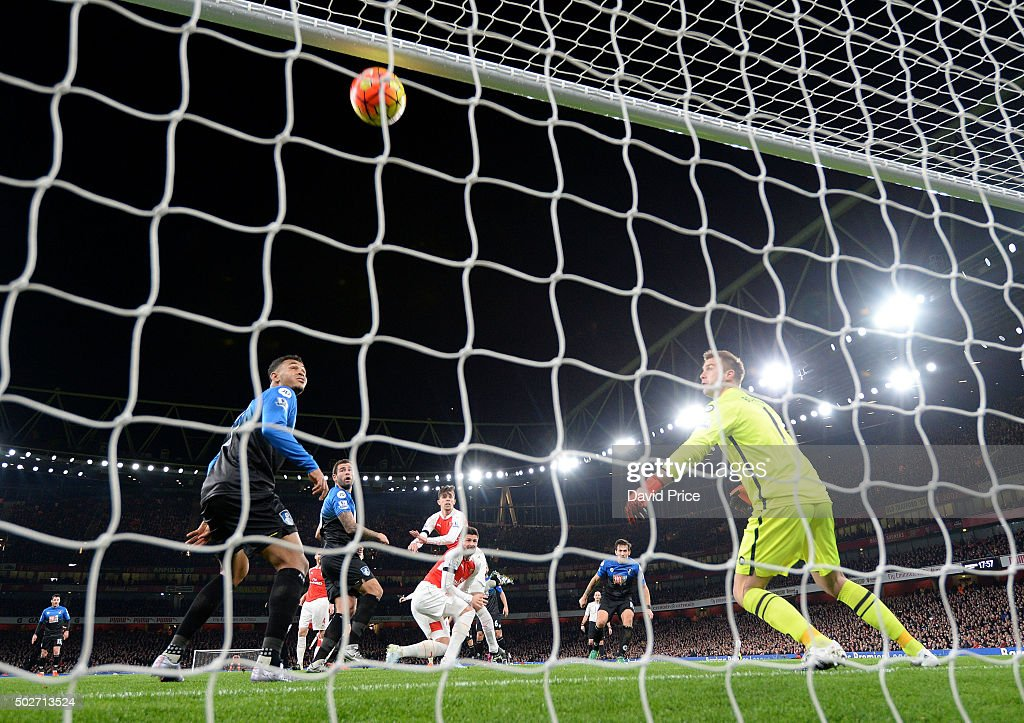 Gabriel scores a goal for Arsenal past <a gi-track='captionPersonalityLinkClicked' href=/galleries/search?phrase=Artur+Boruc&family=editorial&specificpeople=554761 ng-click='$event.stopPropagation()'>Artur Boruc</a> of Bournemouth during the Barclays Premier League match between Arsenal and Bournemouth at Emirates Stadium on December 28, 2015 in London, England.