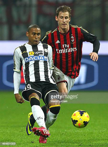 Gabriel Silva of Udinese Calcio competes for the ball with Valter Birsa of AC Milan during the TIM Cup match between AC Milan and Udinese Calcio at...