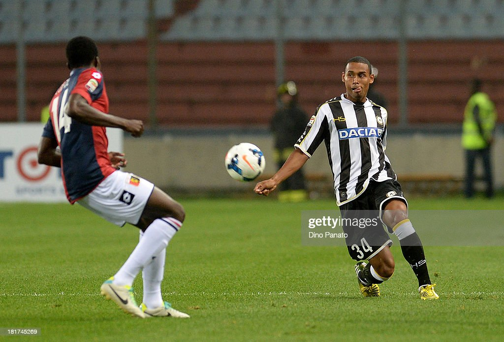 Gabriel Silva (R) of Udinese Calcio competes with Isaac Cofie of Genoa CFC during the Serie A match between Udinese Calcio and Genoa CFC at Stadio Friuli on September 24, 2013 in Udine, Italy.