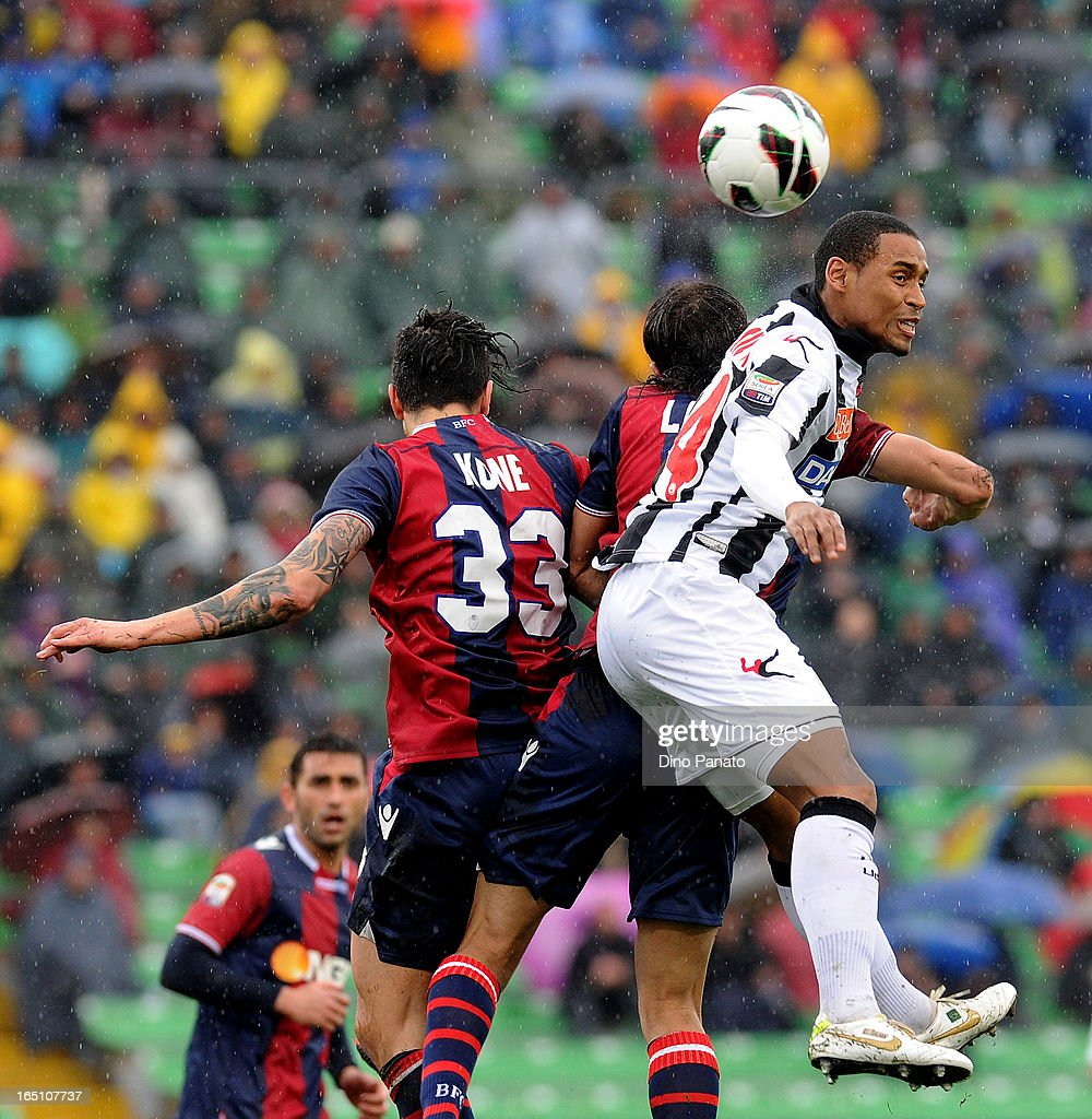 Gabriel Silva (R) of Udinese Calcio competes with Panagiotis Kone of Bologna FC during the Serie A match between Udinese Calcio and Bologna FC at Stadio Friuli on March 30, 2013 in Udine, Italy.