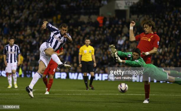 Gabriel Tamas of West Brom scorers the first goal during the Capital One Cup third round match between West Bromwich Albion and Liverpool at The...
