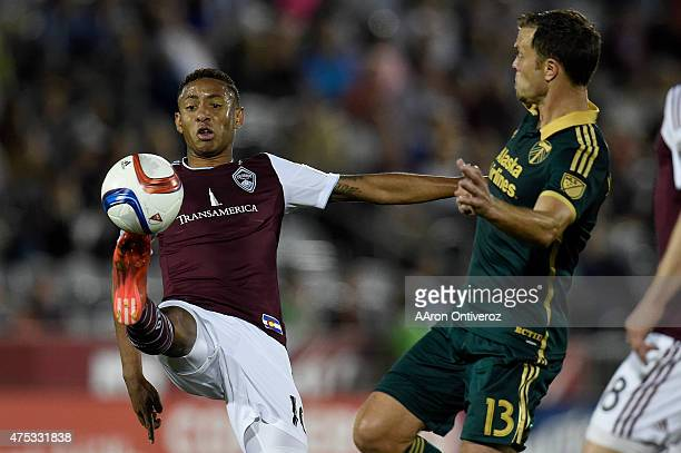 Gabriel Torres of Colorado Rapids kicks the ball away from Jack Jewsbury of Portland Timbers during the second half of Portland's 21 win The Colorado...