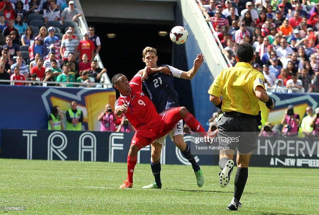 Gabriel Torres of Panama and Clarence Goodson of USA fight for the ball in the first half at the 2013 CONCACAF Gold Cup Final at Soldier Field July...