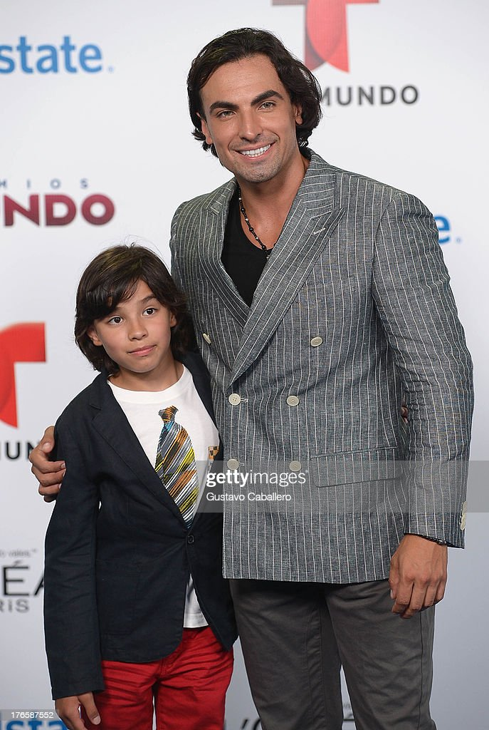 Gabriel Valenzuela (R) arrives for Telemundo's Premios Tu Mundo Awards at American Airlines Arena on August 15, 2013 in Miami, Florida.