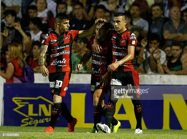 Gabriel Vargas of Patronato celebrates with teammates after scoring the first goal of his team during a match between Patronato and River Plate as...