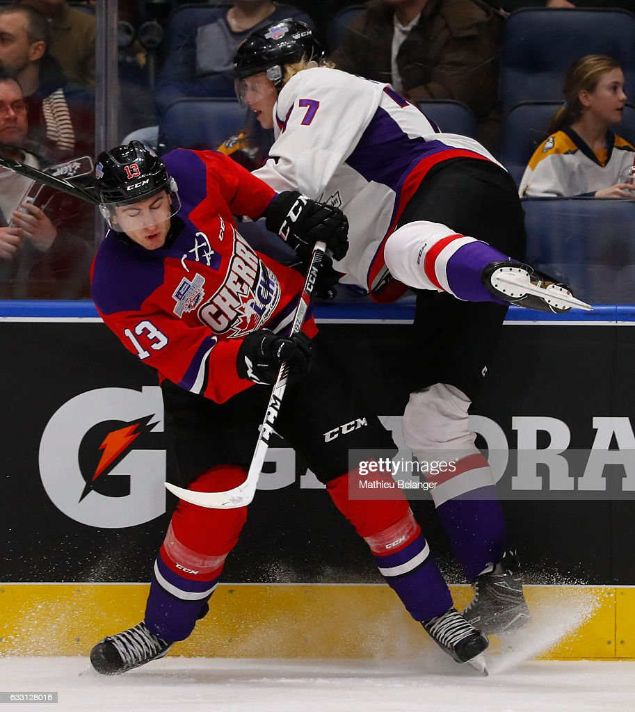 Gabriel Vilardi #13 of Team Cherry and Eemeli Rasanen #77 of Team Orr collide during the third period of their Sherwin-Williams CHL/NHL Top Prospects Game at the Videotron Center on January 30, 2017 in Quebec City, Quebec, Canada.