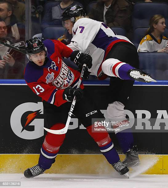 Gabriel Vilardi of Team Cherry and Eemeli Rasanen of Team Orr collide during the third period of their SherwinWilliams CHL/NHL Top Prospects Game at...