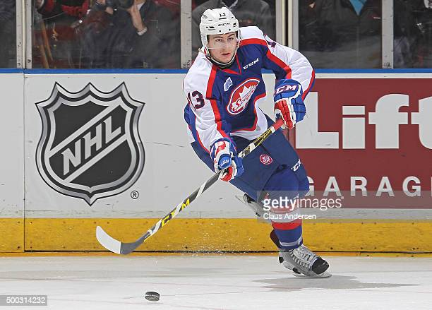 Gabriel Vilardi of the Windsor Spitfires fires a pass against the London Knights during an OHL game at Budweiser Gardens on December 4 2015 in London...