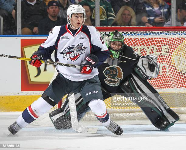 Gabriel Vilardi of the Windsor Spitfires looks for a puck to tip in front of Tyler Parsons of the London Knights during Game One of the OHL Western...