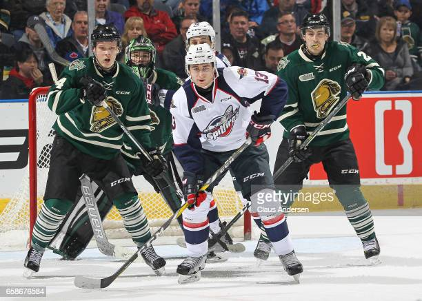 Gabriel Vilardi of the Windsor Spitfires looks for a shot to tip against Olli Juolevi of the London Knights during Game Two of the OHL Western...