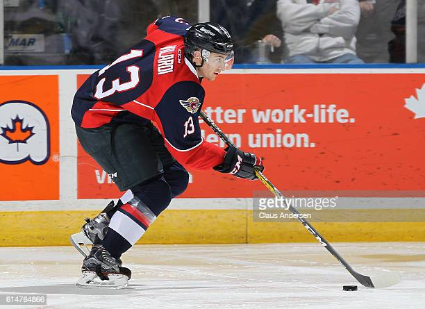 Gabriel Vilardi of the Windsor Spitfires skates with the puck against the London Knights during an OHL game at Budweiser Gardens on October 14 2016...