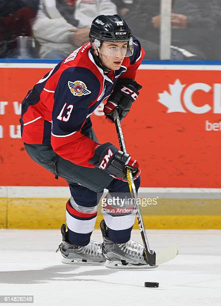 Gabriel Vilardi of the Windsor Spitfires skates with the puck against the London Knights during an OHL game at Budweiser Gardens on October 142016 in...