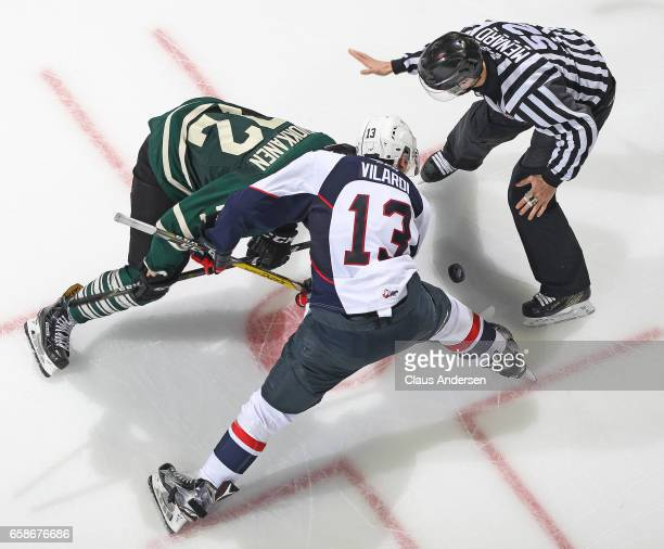Gabriel Vilardi of the Windsor Spitfires takes a faceoff against Janne Kuokkanen of the London Knights during Game Two of the OHL Western Conference...
