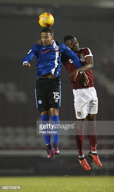 Gabriel Zakuani of Northampton Town contests the ball with Joe Thompson of Rochdale during the Sky Bet League One match between Northampton Town and...