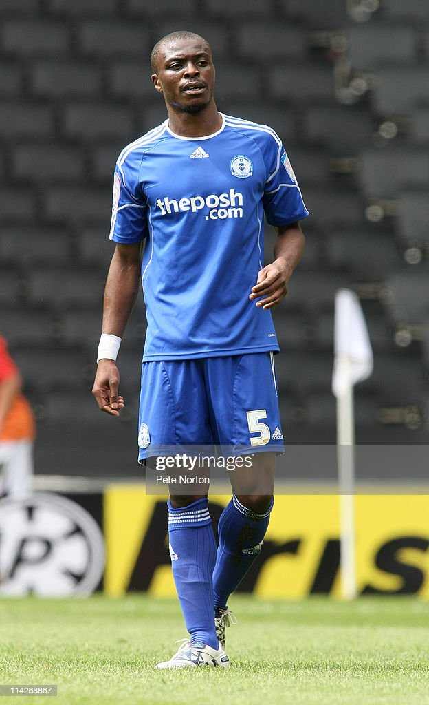 <a gi-track='captionPersonalityLinkClicked' href=/galleries/search?phrase=Gabriel+Zakuani&family=editorial&specificpeople=639100 ng-click='$event.stopPropagation()'>Gabriel Zakuani</a> of Peterborough United in action during the npower League One Play-Off Semi-Final 1st Leg match between Mk Dons and Peterborough United at Stadium MK on May 15, 2011 in Milton Keynes, England.