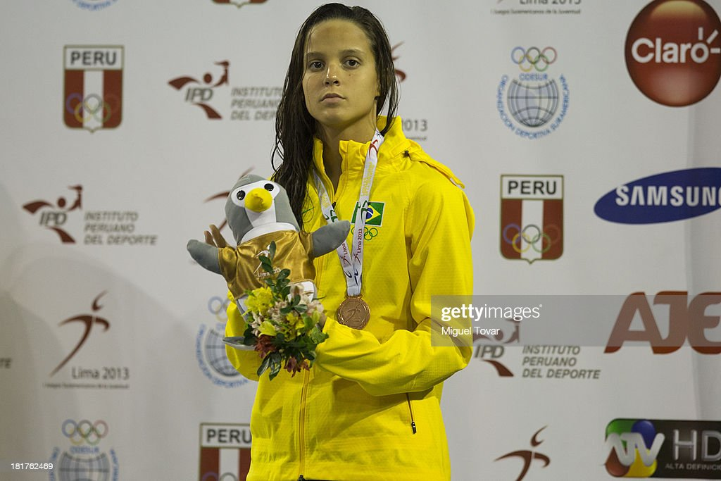 Gabriela Albuquerque of Brazil receives the bronze medal in women's 200 meter Breaststroke as part of the I ODESUR South American Youth Games at Piscina Ol'mpica Campo de Marte on September 24, 2013 in Lima, Peru.
