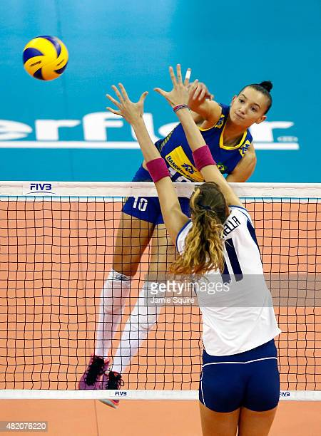 Gabriela Braga Guimaraes of Brazil spikes the ball as Cristina Chirichella of Italy blocks during the final round match on day 5 the FIVB Volleyball...