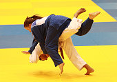Gabriela Clememte of Brazil competes against Amber Pair of the USA in the Women's 48 kg division of the Judo event in the Sports Halls at Sydney...