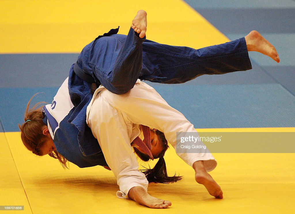 Gabriela Clememte of Brazil (white) competes against Amber Pair of the USA in the Women's 48 kg division of the Judo event in the Sports Halls at Sydney Olympic Park Sports Centre on January 19, 2013 in Sydney, Australia.