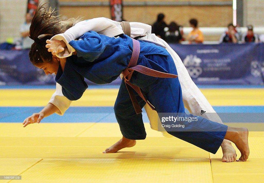 Gabriela Clemente of Brazil (Blue) wins the final and gold medal against Chloe Raynor of Australia in the W-48 kg division of the Judo event in the Sports Halls during day four of the Australian Youth Olympic Festival at Sydney Olympic Park Sports Centre on January 19, 2013 in Sydney, Australia. Clemente won the final.