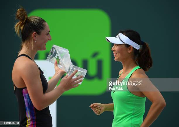 Gabriela Dabrowski of Canada and Yifan Xu of Canada celebrate with their trophy following the women's doubles finals on day 14 of the Miami Open at...