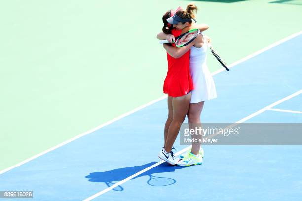 Gabriela Dabrowski of Canada and Yifan Xu of China celebrate after defeating Ashleigh Barty and Casey Dellacqua of Australia during Day 9 of the...