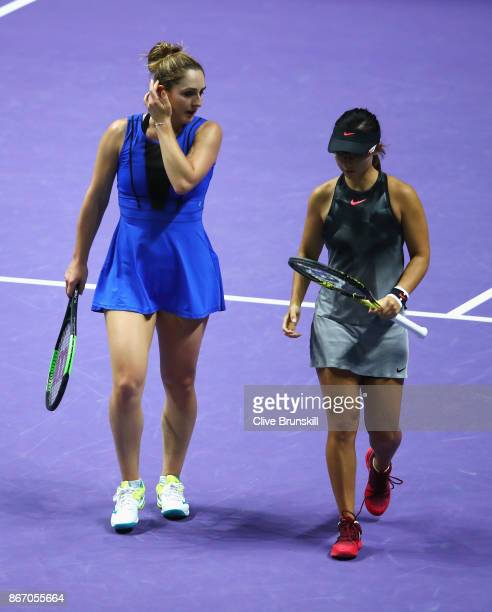 Gabriela Dabrowski of Canada and YiFan Xu of China look dejected in their doubles match against Elena Vesnina and Ekaterina Makarova of Russia during...