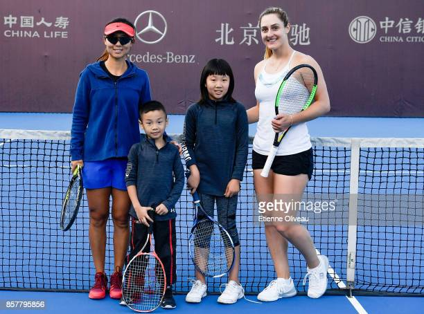 Gabriela Dabrowski of Canada and Yifan Xu of China poses with kids during the Inclub Clinic on day six of the 2017 China Open at the China National...