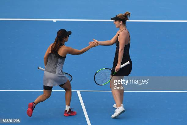 Gabriela Dabrowski of Canada and Yifan Xu of China react during their Women's Doubles Quarterfinals match against YungJan Chan of Chinese Taipei and...