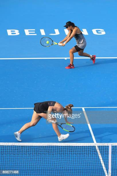 Gabriela Dabrowski of Canada and Yifan Xu of China return a shot against YungJan Chan of Chinese Taipei and Martina Hingis of Switzerland during...
