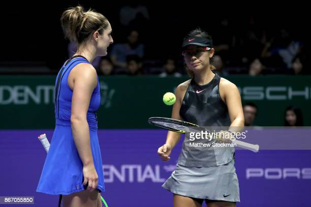Gabriela Dabrowski of Canada and YiFan Xu of China talk in their doubles match against Elena Vesnina and Ekaterina Makarova of Russia during day 6 of...