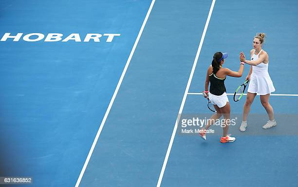 Gabriela Dabrowski of Canada and Zhaoxuan Yang of China celebrate winning a point in their Women's Doubles Final match against Raluca Olaru of...