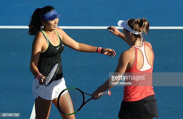 Gabriela Dabrowski of Canada and Zhaoxuan yang of China celebrate winning match point in their semi final match against Demi Schuurs of the...