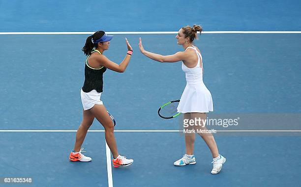 Gabriela Dabrowski of Canada and Zhaoxuan Yang of China celebrate winning set point in their Women's Doubles Final match against Raluca Olaru of...