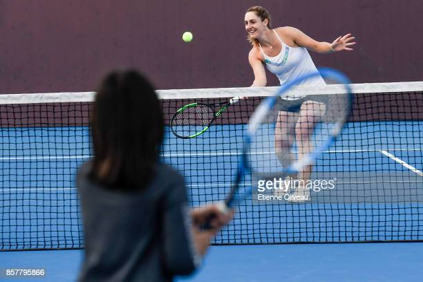 Gabriela Dabrowski of Canada partner of Yifan Xu of China plays tennis with a kid during the Inclub Clinic on day six of the 2017 China Open at the...