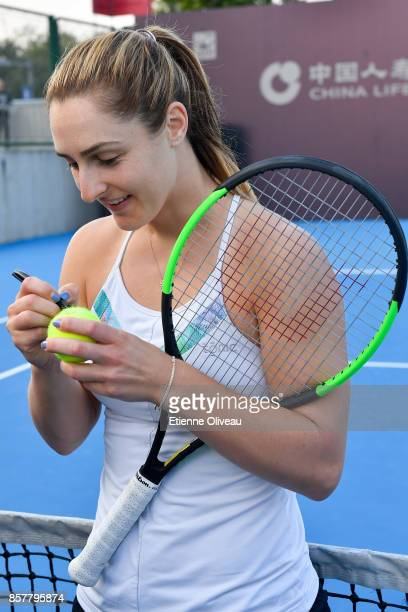 Gabriela Dabrowski of Canada partner of Yifan Xu of China signs an autograph during the Inclub Clinic on day six of the 2017 China Open at the China...