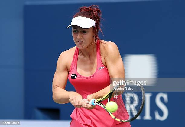 Gabriela Dabrowski of Canada plays a shot against Flavia Pennetta of Italy during Day 1 of the Rogers Cup at the Aviva Centre on August 10 2015 in...
