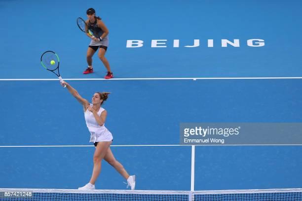 Gabriela Dabrowski of Cananda and Yifan Xu of China return a shot against Raluca Olaru of Romania and Lyudmyla Kichenok of Ukraine on day five of the...